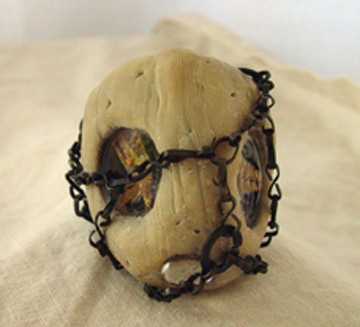 found object, epoxy clay, jewelry, polymer, aged, pitted, optical lens,